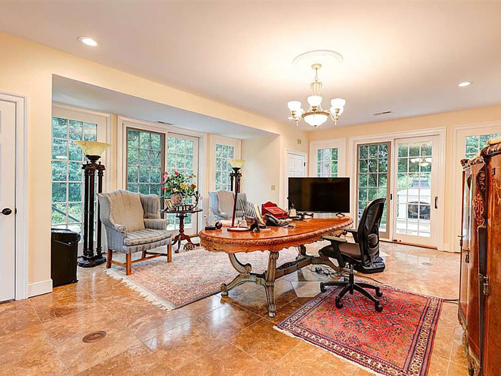 large office surrounded by glass patio doors