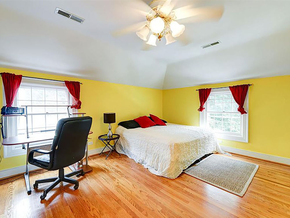 large upstairs bedroom with tray ceiling