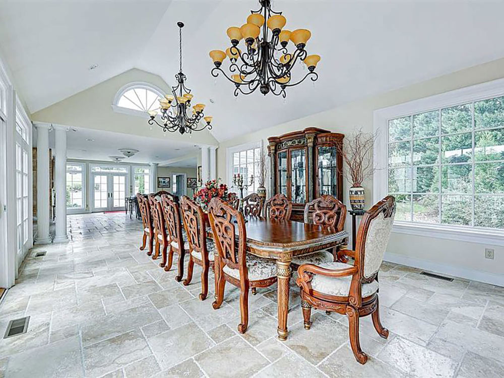 larger formal dining room surrounded by windows