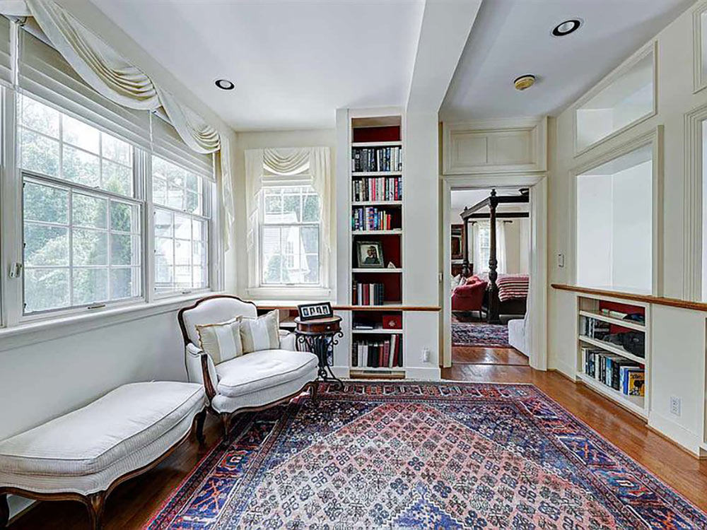 sitting area off master bedroom with built in bookcases