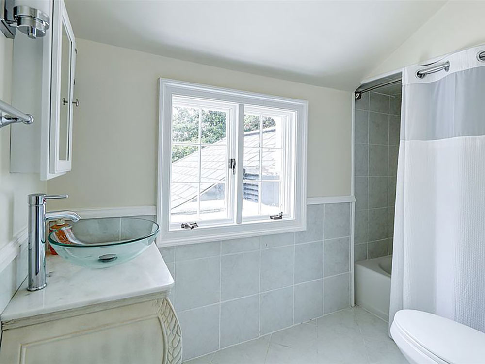 upstairs full bath with glass vessel sink