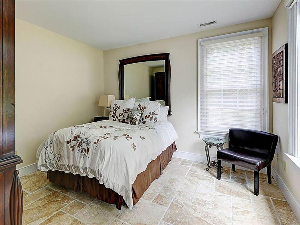 bedroom with stone tile floor