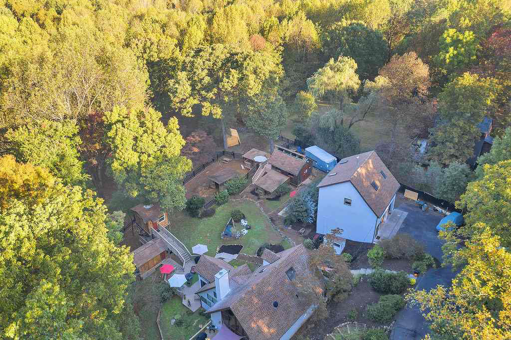 drone shot of the home treehouse and outbuildings