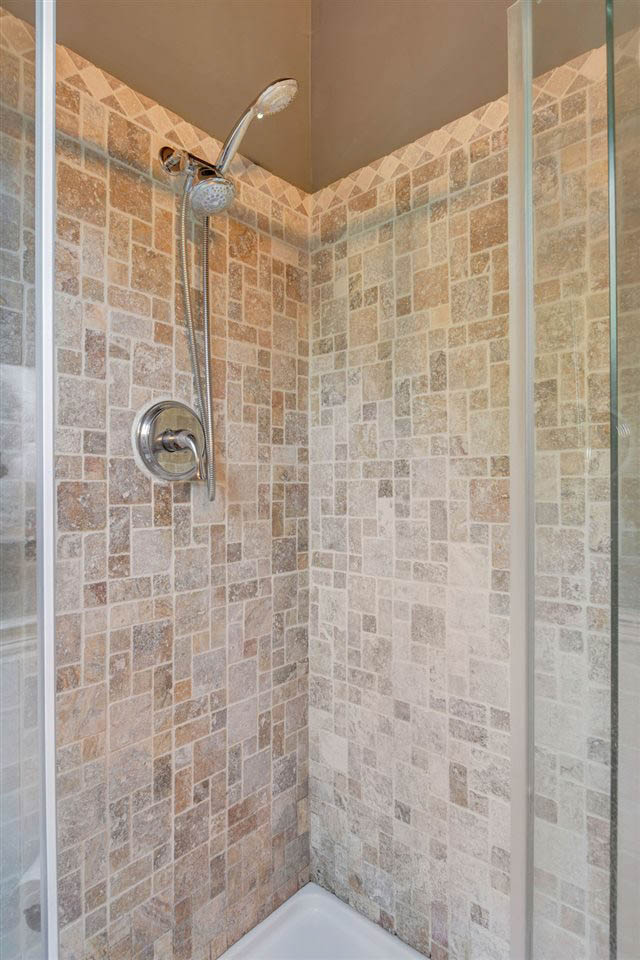 garage apartment tile and glass shower