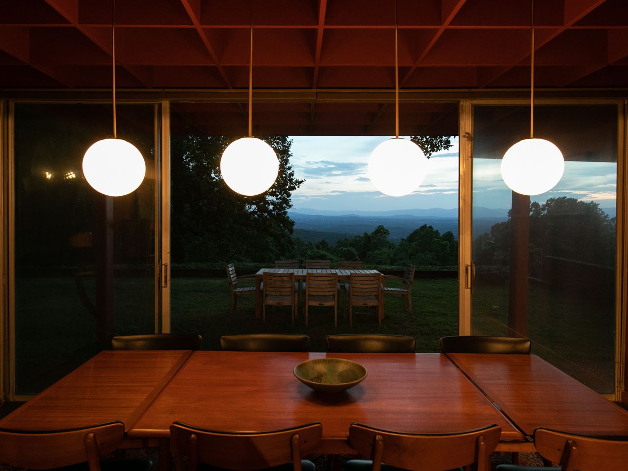 dining room with evening view of mountains