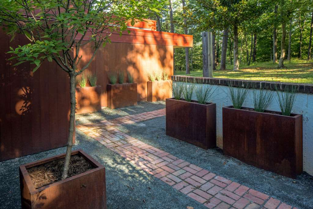 exterior pathway with larg minimalist wood planters