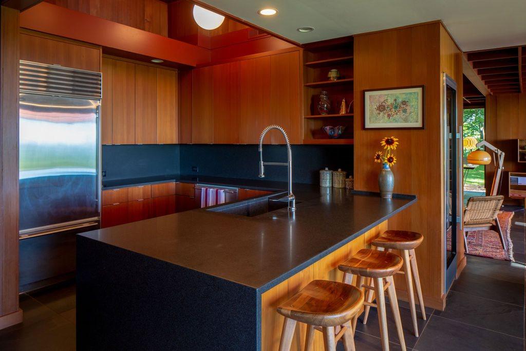 kitchen with breakfast bar and subzero fridge