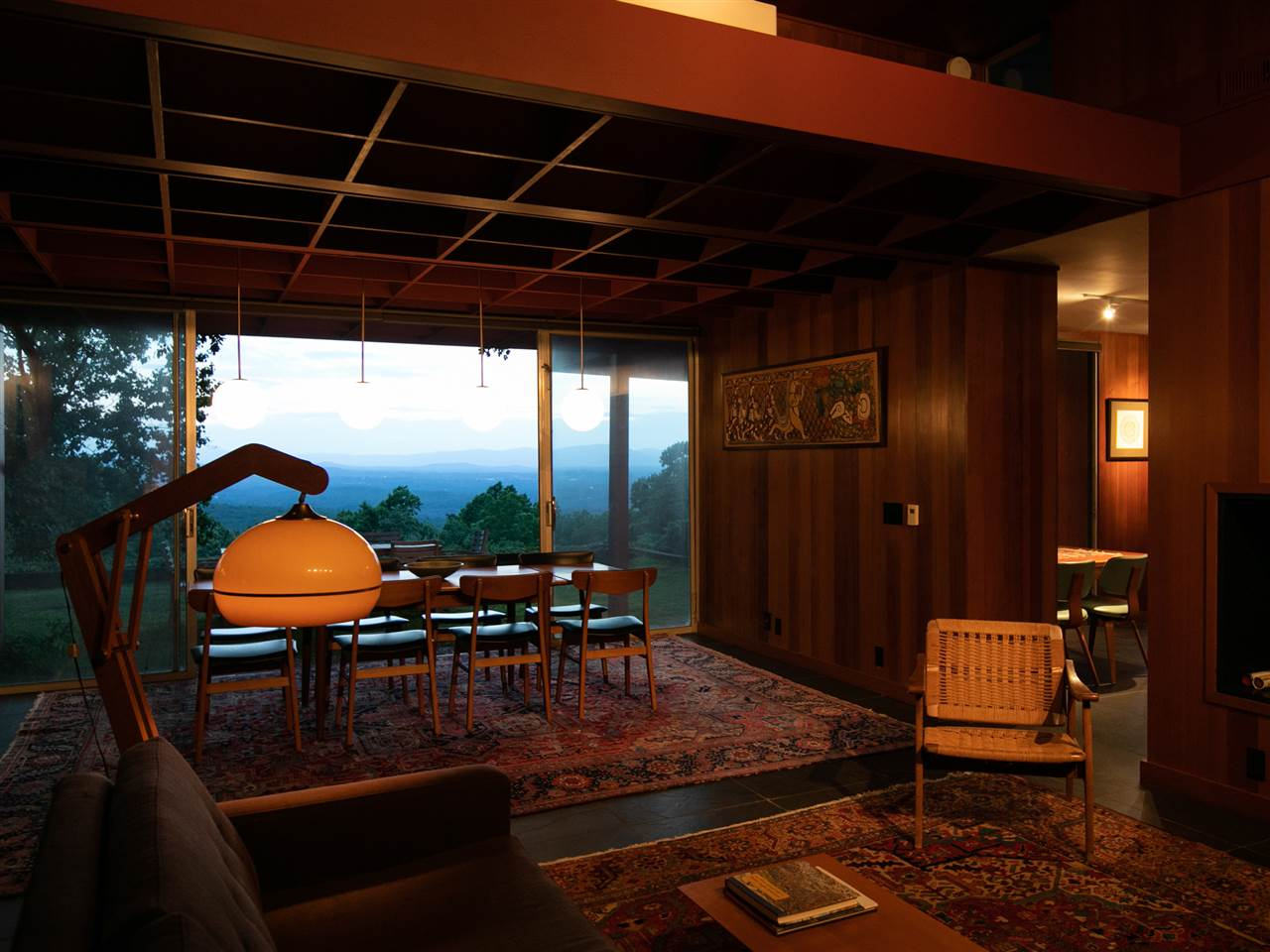 living room and dining area with evening view of mountains