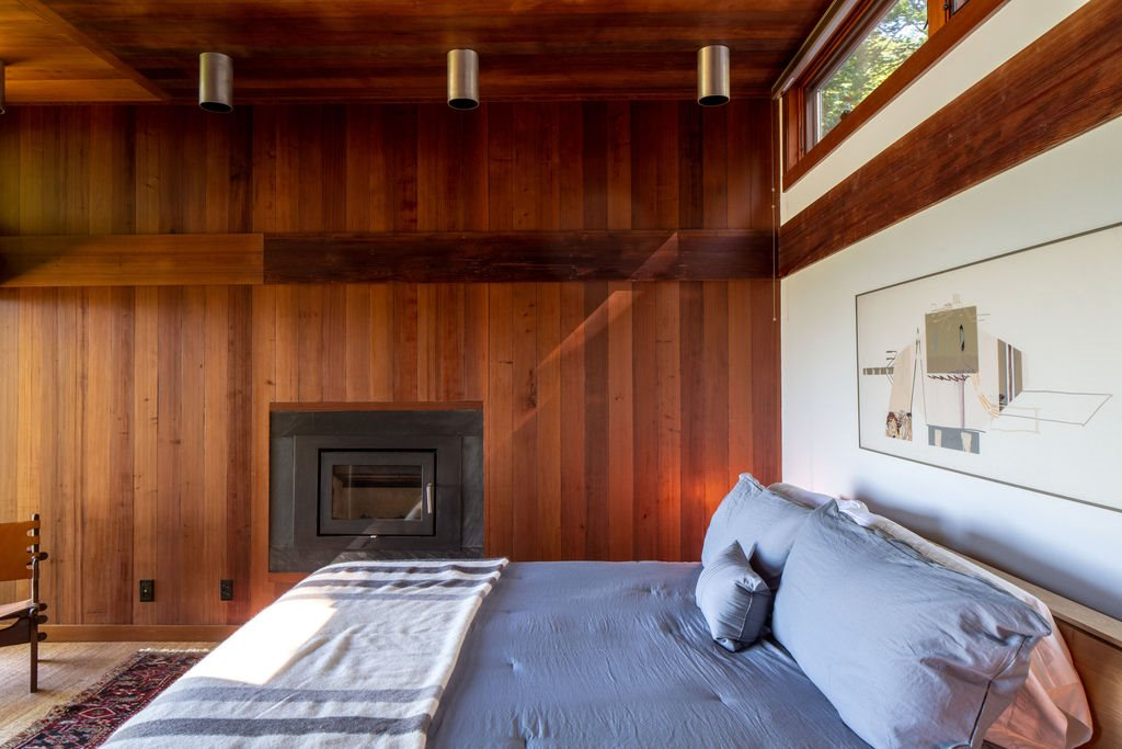 master bedroom with fireplace and gorgous wood ceiling and wall