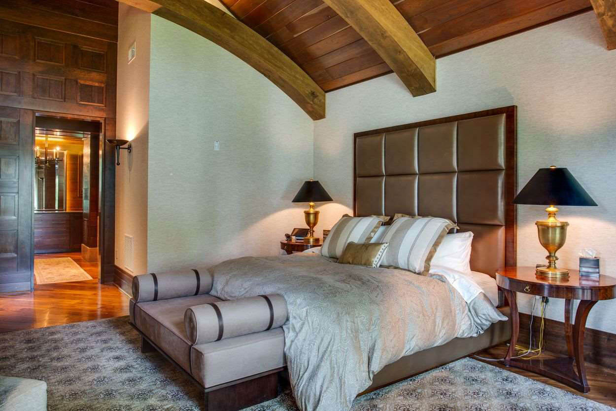 bedroom suite with wood beamed ceiling