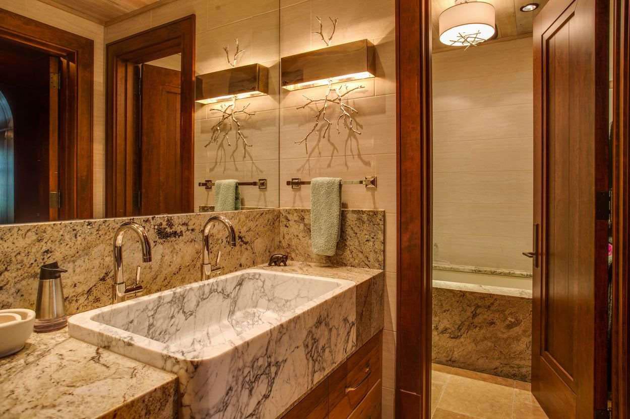 en suite bath with marble tub and huge marble sink