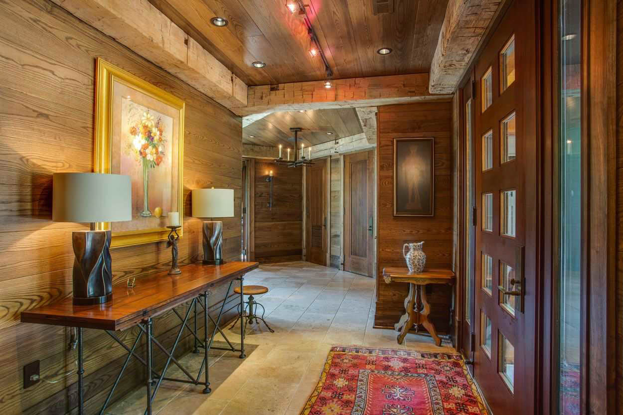 entry hallway with wood panels and ceiling