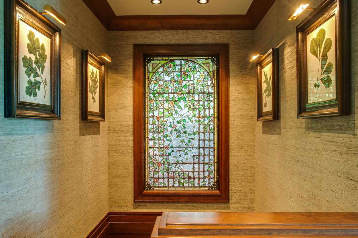 large stained glass window in stairway