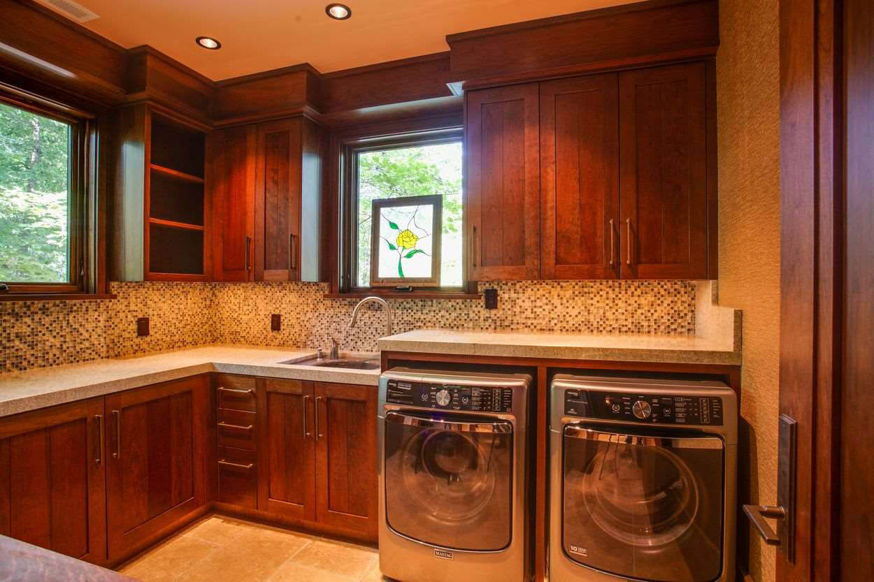 laundry room with wood cabinetry and sink