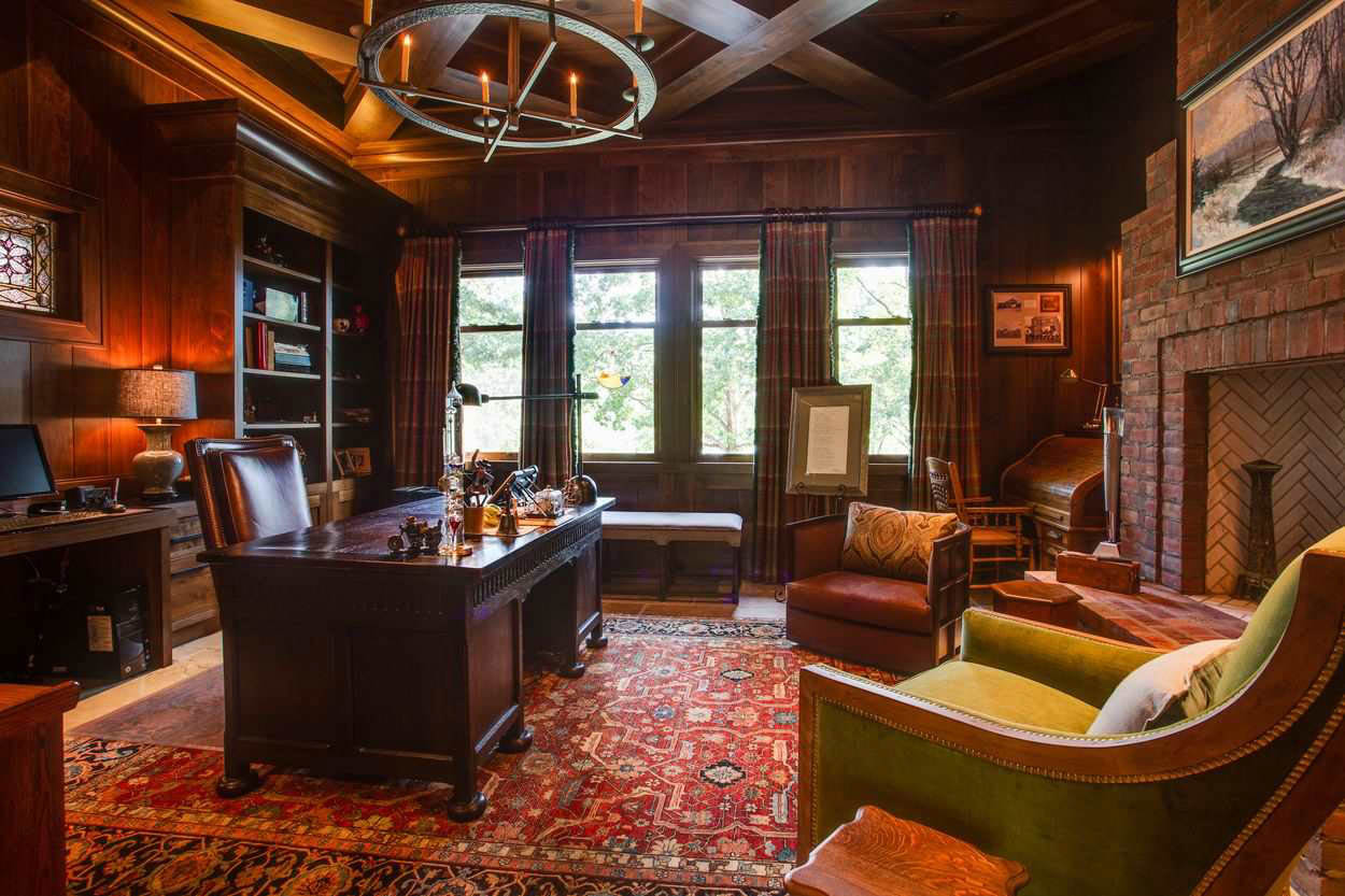 office with huge fireplace and intricate wood ceiling