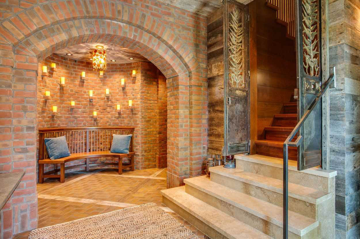 stairway and brick arched alcove seating area