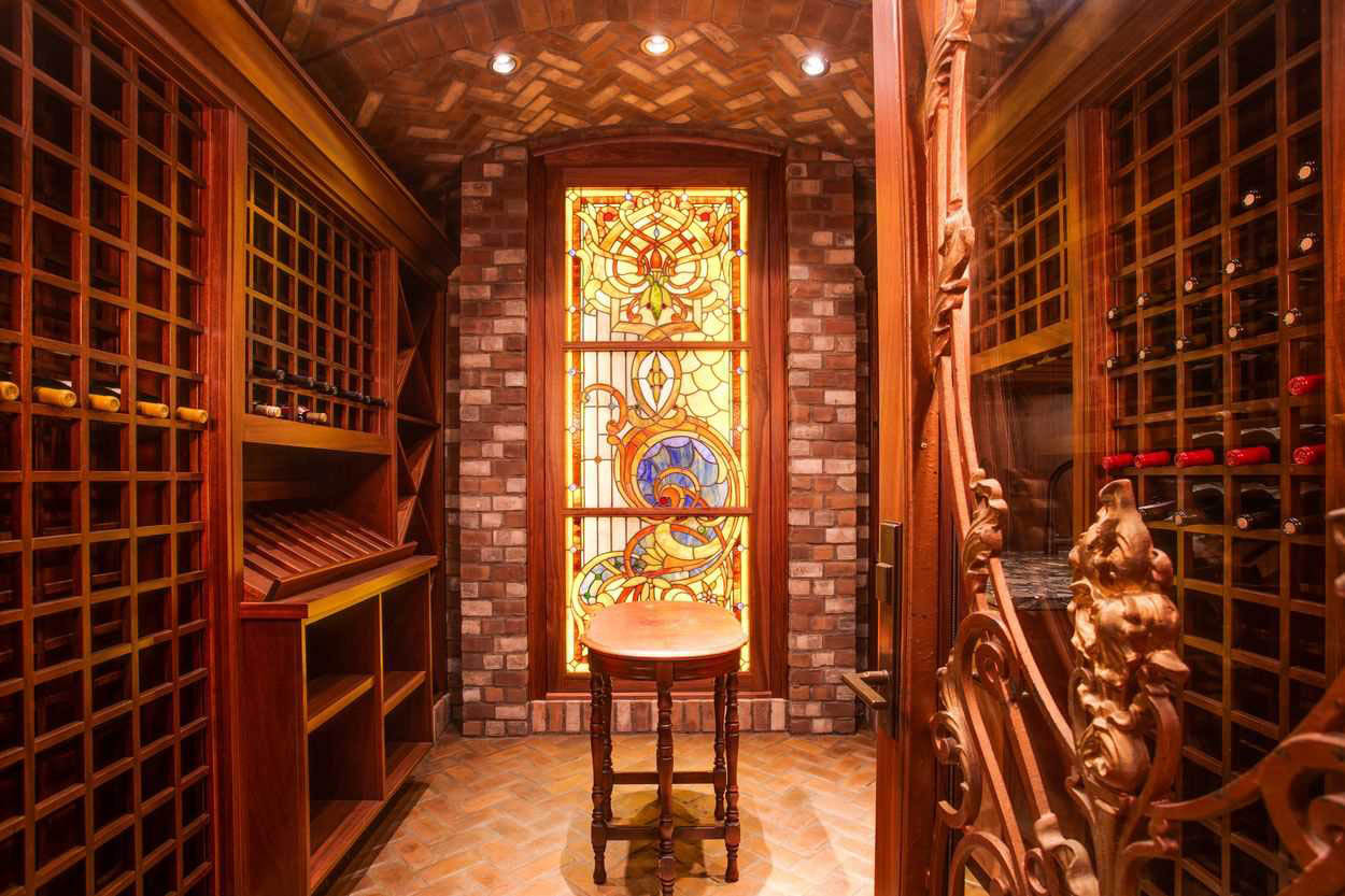wine cellar with large stained glass window