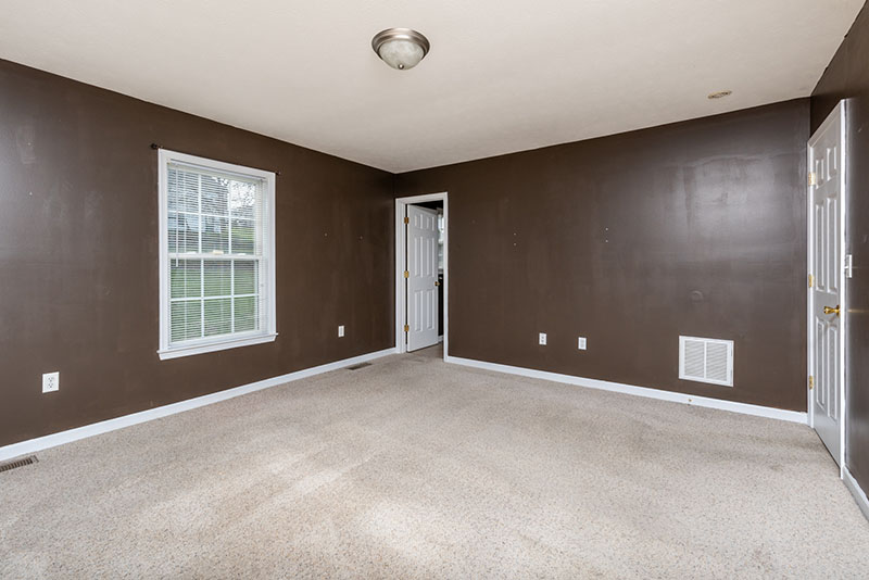 master bedroom with brown walls