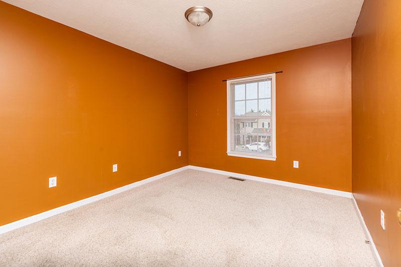 bedroom 3 harvest orange walls and window