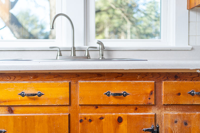 East Side Hwy kitchen sink and knotty pine cabinets