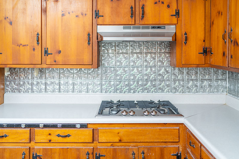 East Side Hwy kitchen stove top and tin backsplash