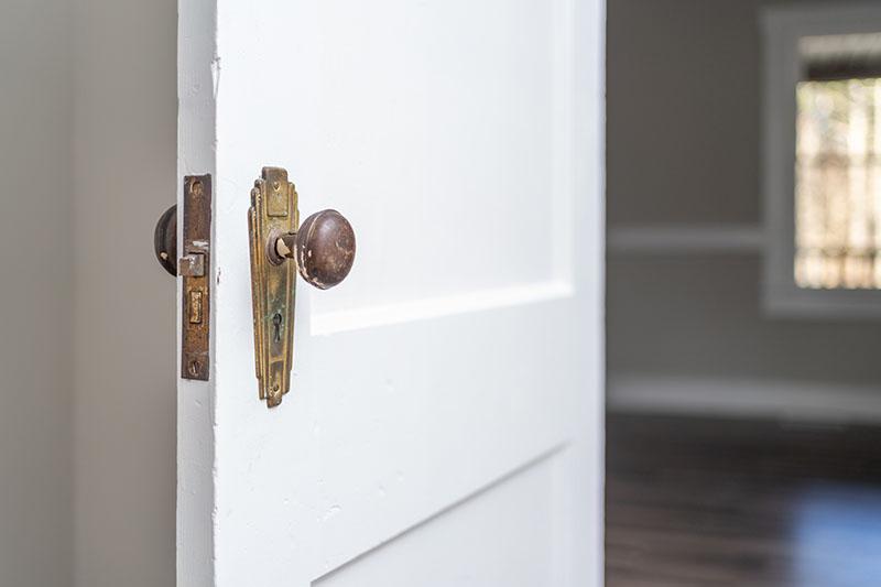 East Side Hwy paneled door with brass door knob