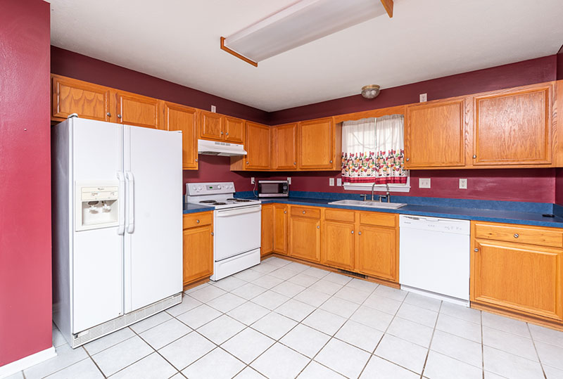 eat in kitchen and side by side fridge