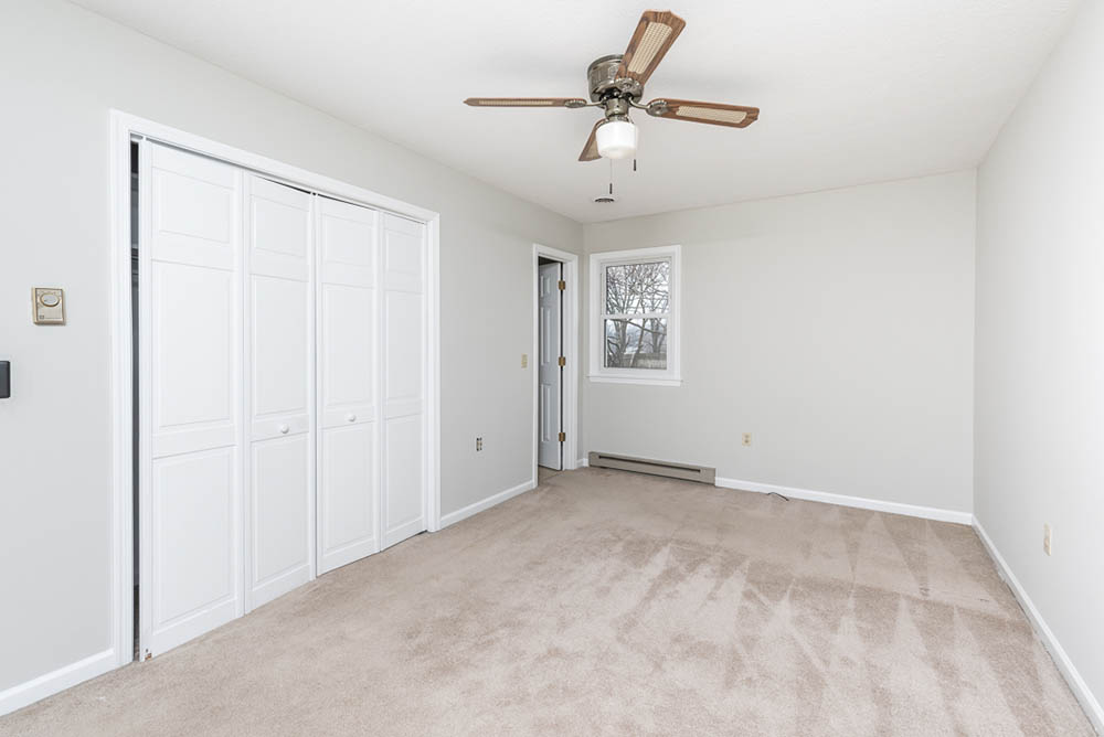 Bedroom one in affordable brick ranch