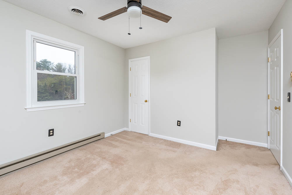 Bedroom three to closet in affordable brick ranch
