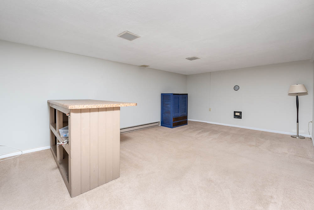 basement and bar in affordable brick ranch