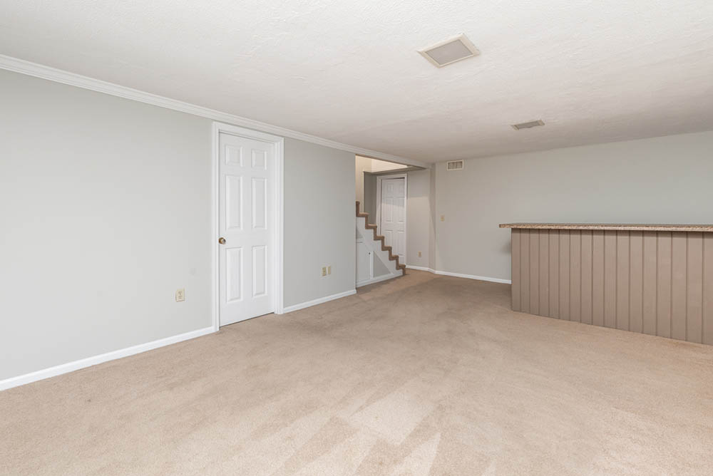 basement and stairs in affordable brick ranch