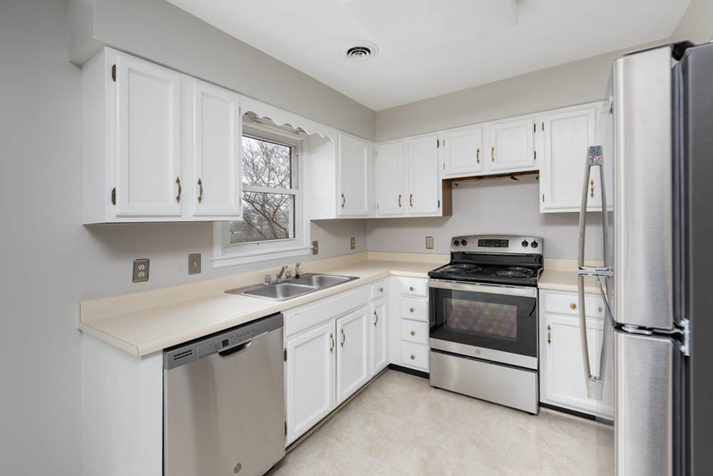 kitchen with window in affordable brick ranch