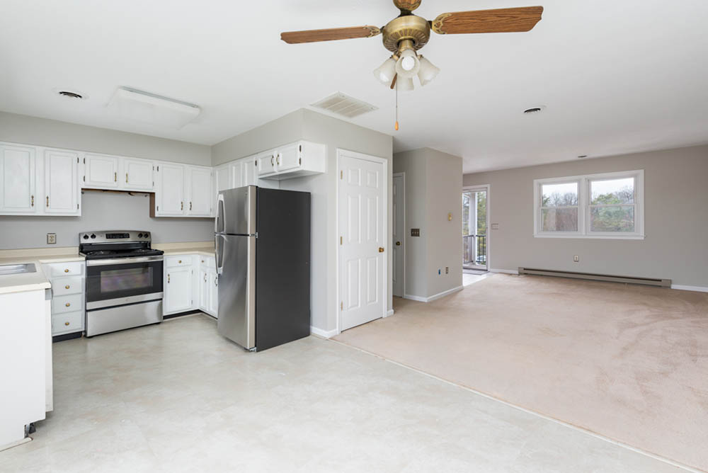 living room kitchen and dining in affordable brick ranch