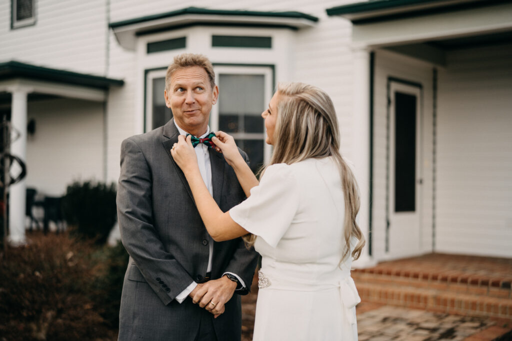 millpond photography daughter adjusting dad's bow tie for a wedding